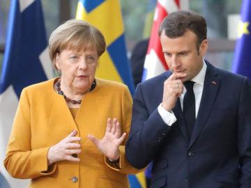 Macron und Merkel diskutieren