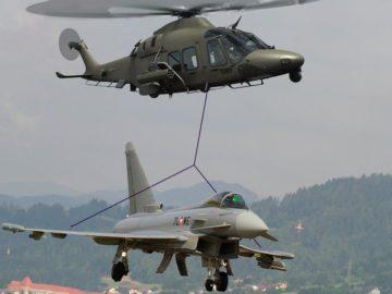 Hubschrauber trägt Eurofighter