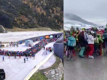 Leute stehen in Tirol dichtgedrängt vor dem Skilift